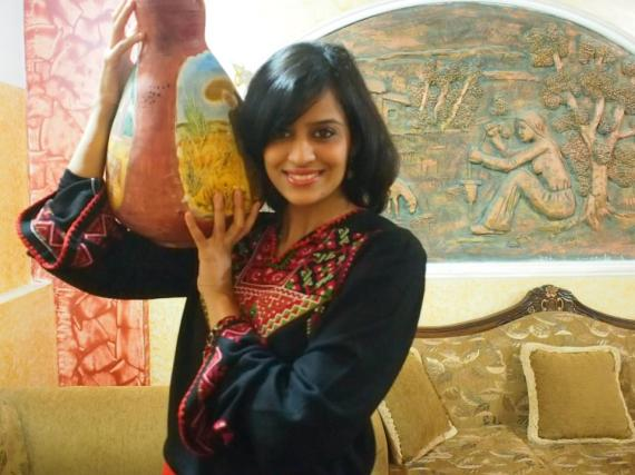 I performed a Dabka performance while carrying the pottery imitating how Palestinian women  before 1948 used to take potteries and go to fill it with water from a well in their  village.