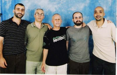 A scaned photo of Loai and his comrades taken in prison. Loai is on the very left. Jihad al-Obeidi is the send from the right.