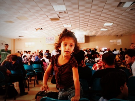 I shot this photo inside the Rafah hall where the travellers wait to hear their names called out