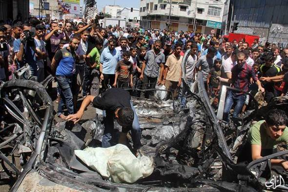 Three Martyrs were killed in an Israeli airstrike that hit a civil bus in Al-Sha'biya crossroad in central Gaza city.