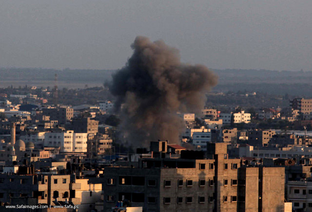 Smoke billows from a building hit by an Israeli air strike in Gaza City, on July 15, 2014 after Israel accepted Egypt's proposal for ceasefire.