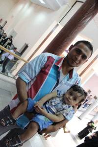 My martyred uncle Mohammed Abu-Louz and his 2-year-old son