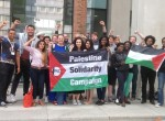 Malia Bouattia (center, holding flag) celebrates passing a 2014 pro-BDS union policy.